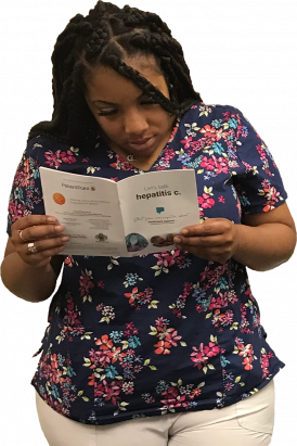 Women reading HCV brochure